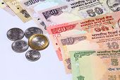 Closeup Of Indian Currency Notes And Coins