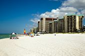 PANAMA CITY BEACH FL - JUNE 4: Crowds dot the beach in Panama City Beach FL on June 4 2014.
