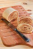 Brazilian Dessert Bolo De Rolo (swiss Roll, Rollcake)  On Wooden Cutting Board