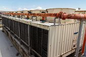 Industrial air conditioner on the roof with blue sky