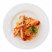Pasta with tomato sauce and langoustines (scampi) isolated on white