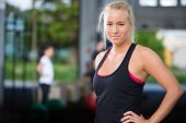 Attractive blonde woman at crossfit gym