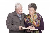 Elderly Couple With A Bible