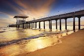 stock photo of sea-scape  - pier shipport with sun set darmatic sky at sea beach - JPG