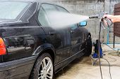 picture of pressure-wash  - car washing cleaning with pressured water - JPG