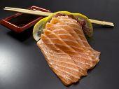 Salmon Sushi Sashimi Over Black Background