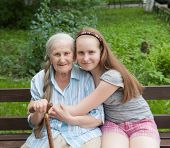 Grandmother With Her Grandaughter Smiling