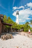 KEY BISCAYNE,USA - MAY 17,2014 : Tourists visit the lighthouse at Key Biscayne, a famous Florida lan