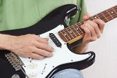 Posing hands of rock musician playing the electric guitar