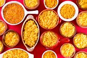 Several Bowls Of Cheese Macaroni Served Conceptually