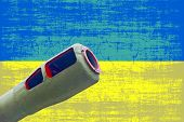 Artillery Cannon Against Of Destroyed Ukrainian Flag