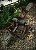 stock photo of seesaw  - Wooden horse seesaw in a playground or outdoor - JPG