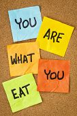 healthy lifestyle concept - you are what to eat reminder words handwritten of sticky notes
