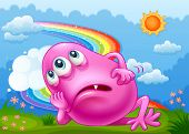 Illustration of a tired pink monster at the hilltop with a rainbow in the sky
