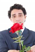 Sad And Emotionally Affected By Woman Man In A Suit Holding A Red Rose