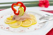 Fish Carpaccio On Lemon,  Decorated With Red Bell Pepper Slice And Lime