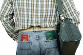 Passenger Holding Tonga And Russian Passports In Rear Pockets