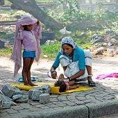 Indian Woman In Sari Takes Care About Her Children