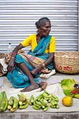 Indian women selling greengrocery at street market place