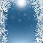 Christmas Snowflakes And Sun On Blue Background.