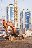Excavator On Building