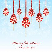 Christmas Lollipops With Bow On Snowy Background