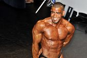 Male Bodybuilding Contestant Showing His Chest Pose