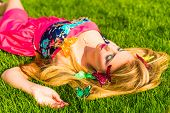 Beautiful Girl Lying On A Grass In Park