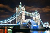 Tower Bridge over Thames River at night in London
