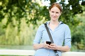 Woman Texting From A Park