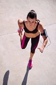 active woman running workout view from above overhead as she jogs