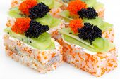 Maki Sushi With Salmon, Red And Black Caviar. Topped With Tobiko