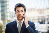 Portrait of a businessman talking on the phone