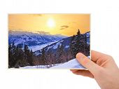 Mountains sunset (Austria) photography in hand (my photo) isolated on white background