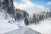 image of slippery-roads  - Empty snow covered road - JPG