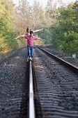Two Children On Rail