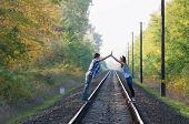 Teen Girl And Boy Posing On Rails