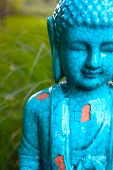 image of gautama buddha  - an aqua colored Gautama Buddha statue in a garden - JPG