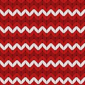 Seamless red and white knitted pattern.