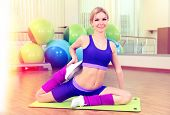 Sporty woman doing exercises in gym