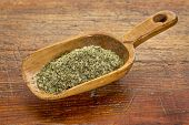 sea lettuce flakes on a rustic wooden scoop against grunge wood
