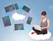 Pretty young girl sitting on cloud enjoying cloud network service