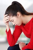 Thoughtful woman with problem or depression