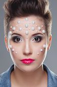 Fashion woman with professional rhinestone make up. Studio lighting
