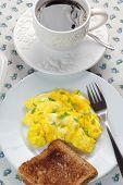 Closeup of scrambled eggs and toast.
