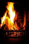 Burning Fireplace. Chimney And Woodpile. Chimney Place. Christmas Fireplace.
