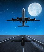Landing passenger airplane in night.