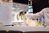 Bartender is pouring champagne