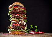 foto of hamburger-steak  - Delicious big hamburger on wooden background - JPG