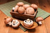 image of agaricus  - Fresh brown mushrooms in wooden box on board - JPG